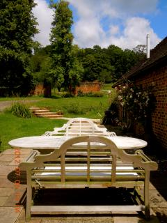 Patio with roeses and steps to the walled garden