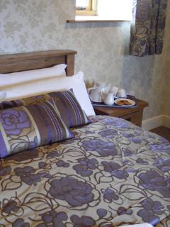 En suite bedroom with kingsize and single bed