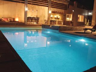 Pool, Bar, Lounge and Dining at night