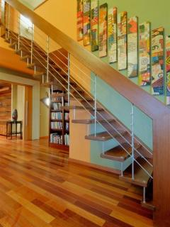 Stairs leading to the 2nd level of the penthouse with decorative artwork