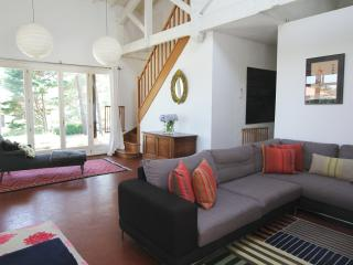 Sitting room, opens on to verandah & into 'Den' room. Stairs up to double bedroom.