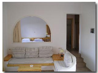 sitting corner with the bedroom in the back