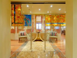 Further stained glass and onyx walls welcome you to the penthouse