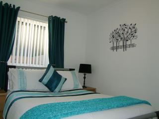 Comfortable double bedroom with dressing table and built-in wardrobe