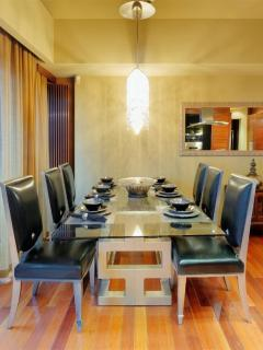 Dining area with seating for 6 and crystal chandelier