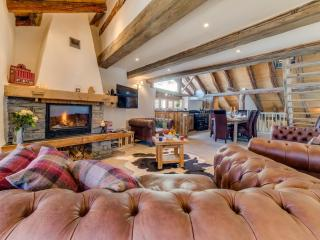 Large open plan living/dining area features log fire