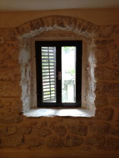 Window onto courtyard from middle floor