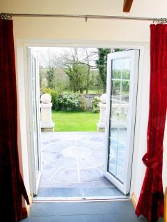 Living area has patio doors opening onto the garden