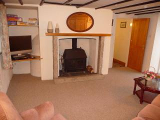 Sitting room with wood burner and door leading out to BBQ area