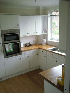 Kitchen with integral appliances, dishwasher, washing machine, fridge/freezer, microwave etc