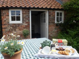 A warm welcome at Nordham Cottages - 'time for tea'  in Horseshoe's sunny walled cour