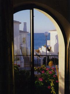 looking through one of the five veranda doors to the sea