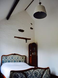 Lime washed wall high ceiling with timber beams