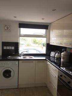 Kitchen showing washing machine and sink