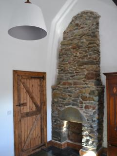 Old stone fire place on bedroom with barn doors and fittings