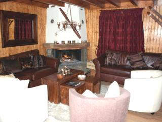 Main lounge with comfy, relaxing leather sofas seats 10 people next to log fire.