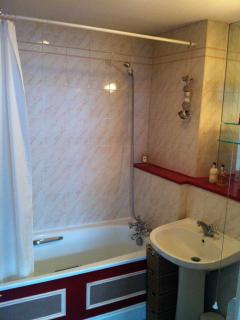 The ensuite bathroom with bath and shower