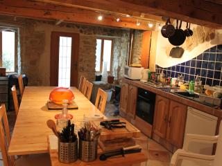 Another view of the kitchen dining room, not showing how many tools and utensils are there!