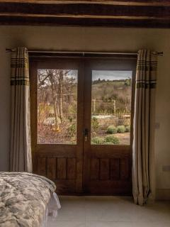 Doors from bedroom 2 leading to the patio,vegetable patch and wildlife garden