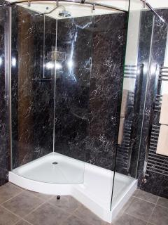 Luxury en suite bathroom with shower, double ended bath and twin sinks