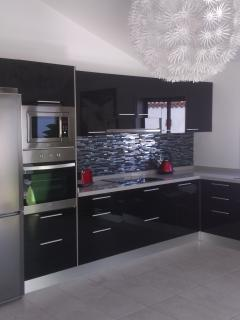 If you want to cook in, our fully fitted kitchen is ideal