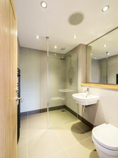 Ensuite bathroom with walk-in shower attached to double bedroom one.