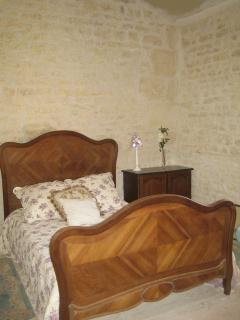 Lovely comfy bedroom with antique french bed in bedroom 3
