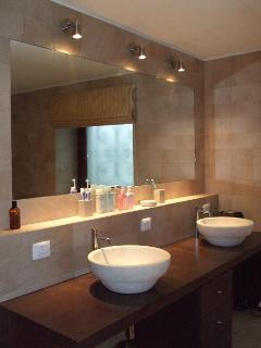 Travertine His & Hers basins in Master en suite