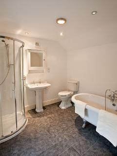 Family bathroom in main house (upstairs) with separate shower cubicle and free standing bath