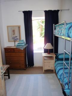Bunk room with cot and baby equipment