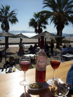 Enjoying wine and Tapas at a beach bar