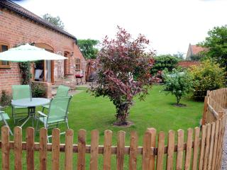 Barn Cottage with private garden and patio,to keep the little ones in or barbecuing etc .