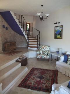 living room and staircase to first floor