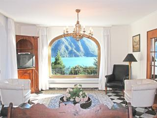 Garden-floor-apt. near lake, aircond.,shared pool, Lugano