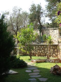 Surrounded by  garden with lemon trees, a herb garden and BBQ
