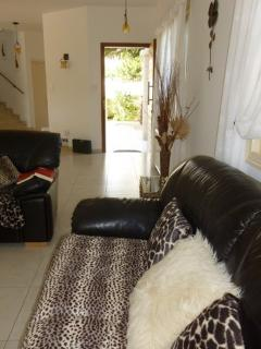 Internal view - leather sofas, 1 being sofa bed, with modern throws and cushions.