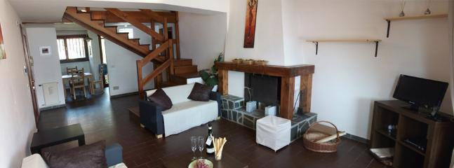 Large cosy open lounge with plenty of seating arrangement and chimney.