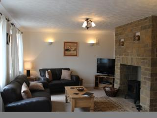 The lounge is large and has a log burner. Great for staying in oncold evenings watching a DVD.