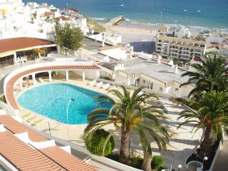 View from your balcony to the communal salt water pool and Old Town Albufeira Beach and Square
