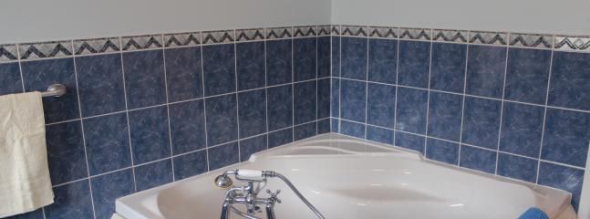 Deep corner bath in family bathroom