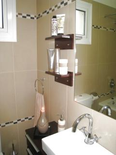 Modern fittings in the master bathroom. There is an en suite shower room too & a separate WC.