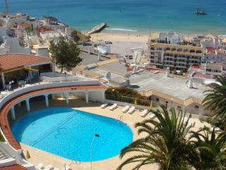 Communal salt water pool, beach and Old Town Albufeira and beach beyond