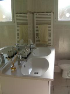 Modern bathroom with his and hers hand basins