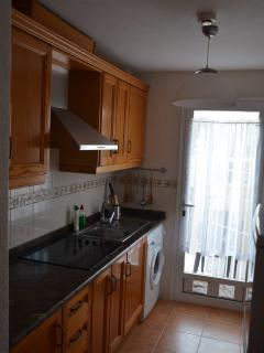 kitchen with direct entrance to terrace and gated communal garden