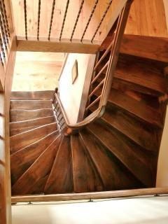 The authentic winding chestnut staircase leading to the 1st floor.
