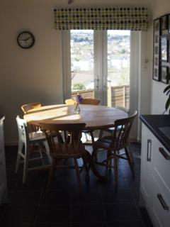 The sunny kitchen diner with french doors opening onto a lawned area. Views across Wadebridge.