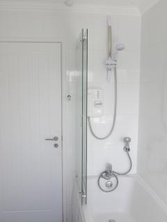 Ground floor family bathroom with bath and electric shower