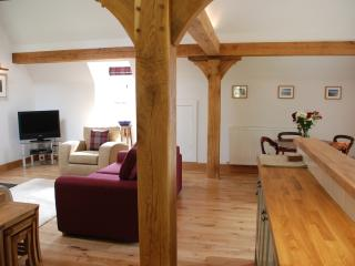 Baillie Scott Cottage open plan living/kitchen/dining area with solid oak posts & beams