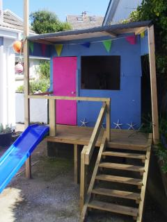 The playhouse in the enclosed backgarden.