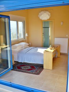 The west bedroom has concertina doors to a sunny terrace, shaded with a pergola